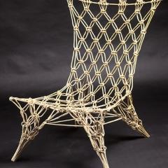 Title: 'Knotted Chair' Designer: Marcel Wanders Year: 1996 Material: aramide, carbon, epoxy resin Technique: macramé, fixed Production: Droog design Dimension: 74 x 55 x 65 cm Collection TextielMuseum Inv. No.: 10152a Photo: Joep Vogels/TextielMuseum