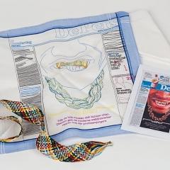 Title: 'Daily Handkerchief' Designer: Studio Makkink & Bey Year: 2010 Material: cotton, paper, metal, plastic Technique: printed, embroidered Commissioner: Droog design Dimension: 28 cm h x 28 cm w x 16 cm d Collection TextielMuseum Inv. No.: 17700 Photo: Josefina Eikenaar/TextielMuseum