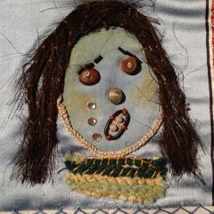 Eine Arbeit von 2004 in einem von mir gestaltetem Stoffbilderbuch: ein trauriges Gesicht